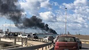 A smoke rises from a port of Tripoli after being attacked in Tripoli, Libya February 18, 2020. REUTERSAhmed Elumami OK